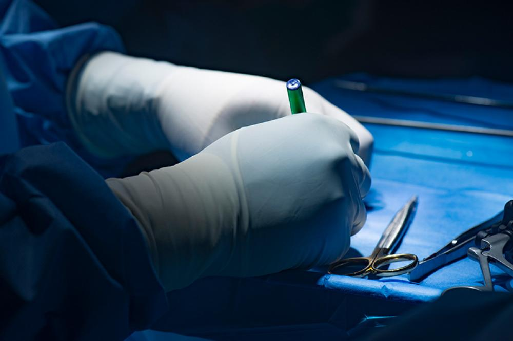 Surgeon preparing for combined hernia repair